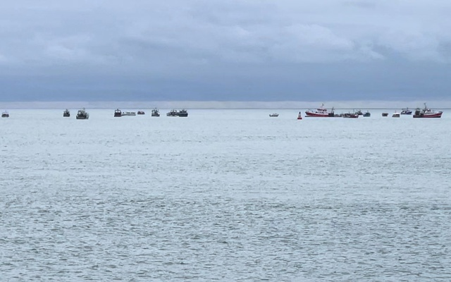Boats are seen in the only channel that allows access to the harbour, in St Helier, Jersey, May 6, 2021, in this picture obtained from social media. Thomas Meany/via REUTERS
